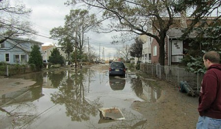 Tim Kinneman, nephew of Oak Ridge resident Jim Kinneman, looks down a flooded street in Keansburg, N.J. in the aftermath of Hurricane Sandy�s passage through the mid-Atlantic state.